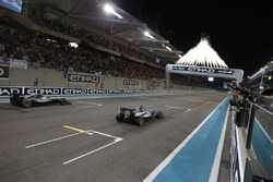 Race winner Lewis Hamilton, Mercedes AMG F1 W07 Hybrid crosses the finish line at the end of the race with second place World Champion Nico Rosberg, Mercedes AMG F1 W07 Hybrid