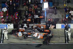Christopher Bell, Kyle Busch Motorsports Toyota, pits as officials indicate 5 minutes to fix the vehicle