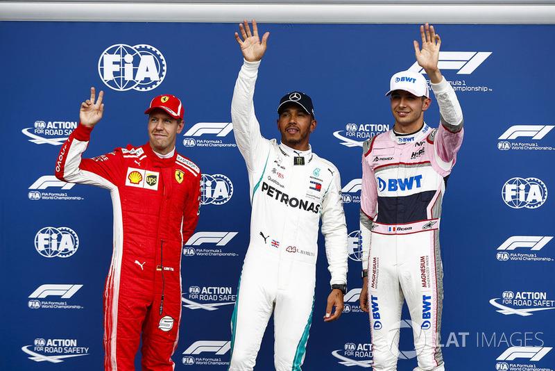 Sebastian Vettel, Ferrari, with Esteban Ocon, Racing Point Force India VJM1, Lewis Hamilton, Mercedes AMG F1