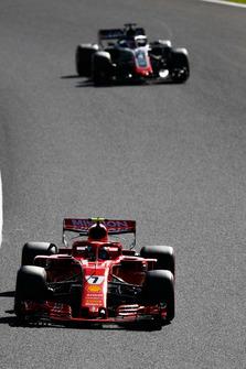 Kimi Raikkonen, Ferrari SF71H, leads Romain Grosjean, Haas F1 Team VF-18
