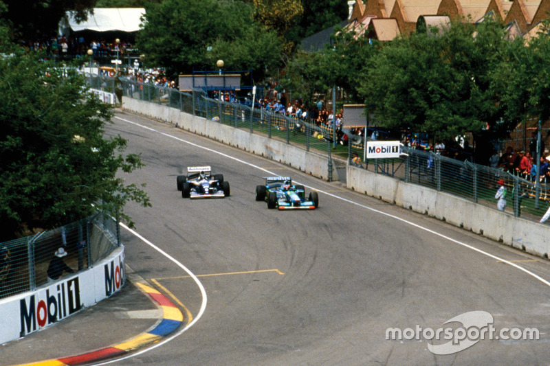 Michael Schumacher, Benetton B194 Ford leads Damon Hill, Williams FW16B Renault
