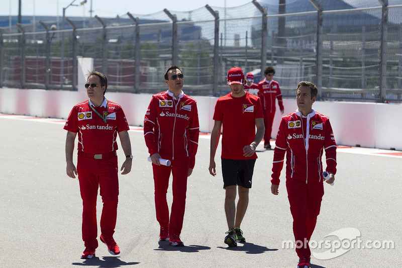 Antonio Giovinazzi, Ferrari Test and Reserve Driver walks the track, Riccardo Adami, Ferrari Race Engineer