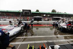 Felipe Massa, Williams FW40, Lance Stroll, Williams FW40, are returned to the garage
