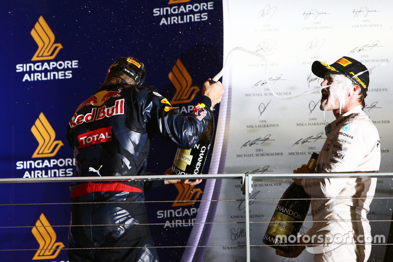 Daniel Ricciardo, Red Bull Racing celebrates his second position on the podium with race winner Nico Rosberg, Mercedes AMG F1