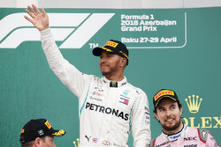 Kimi Raikkonen, Ferrari, 2nd position, Lewis Hamilton, Mercedes AMG F1, 1st position, and Sergio Perez, Force India, 3rd position, on the podium