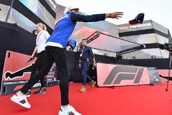 Pierre Gasly, Scuderia Toro Rosso throws a cap at the Fan Zone