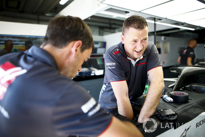 Haas mechanics work in the team's garage