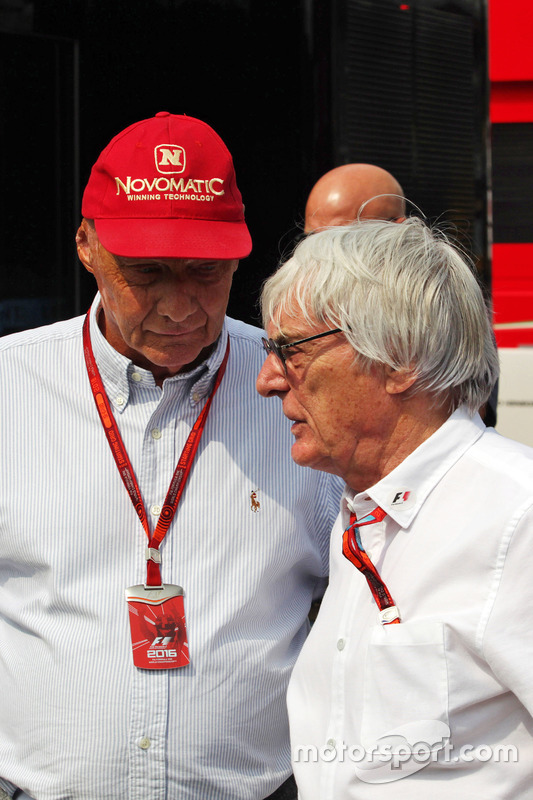 (L to R): Niki Lauda, Mercedes Non-Executive Chairman with Bernie Ecclestone,