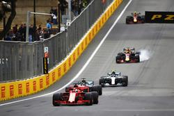 Sebastian Vettel, Ferrari SF71H, leads Lewis Hamilton, Mercedes AMG F1 W09, Valtteri Bottas, Mercedes AMG F1 W09, Daniel Ricciardo, Red Bull Racing RB14 Tag Heuer, and Max Verstappen, Red Bull Racing RB14 Tag Heuer