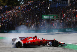Sebastian Vettel, Ferrari SF70H, performs doughnuts as he returns to the pits after winning the race