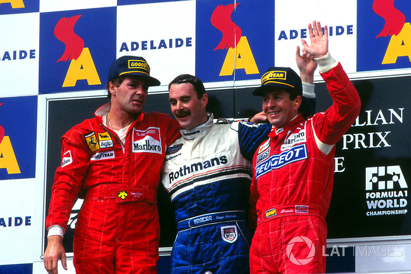 Podium: race winner Nigel Mansell, Williams, second place Gerhard Berger, Ferrari, third place Marti