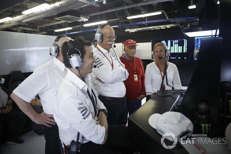 Toto Wolff, Executive Director Mercedes AMG F1, Dr Dieter Zetsche, CEO, Mercedes Benz, Niki Lauda, Non-Executive Chairman, Mercedes AMG F1, watch as Valtteri Bottas, Mercedes AMG F1, takes pole