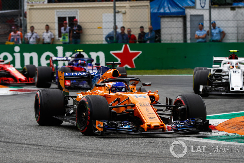 Fernando Alonso, McLaren MCL33, leads Charles Leclerc, Sauber C37, and Pierre Gasly, Toro Rosso STR13
