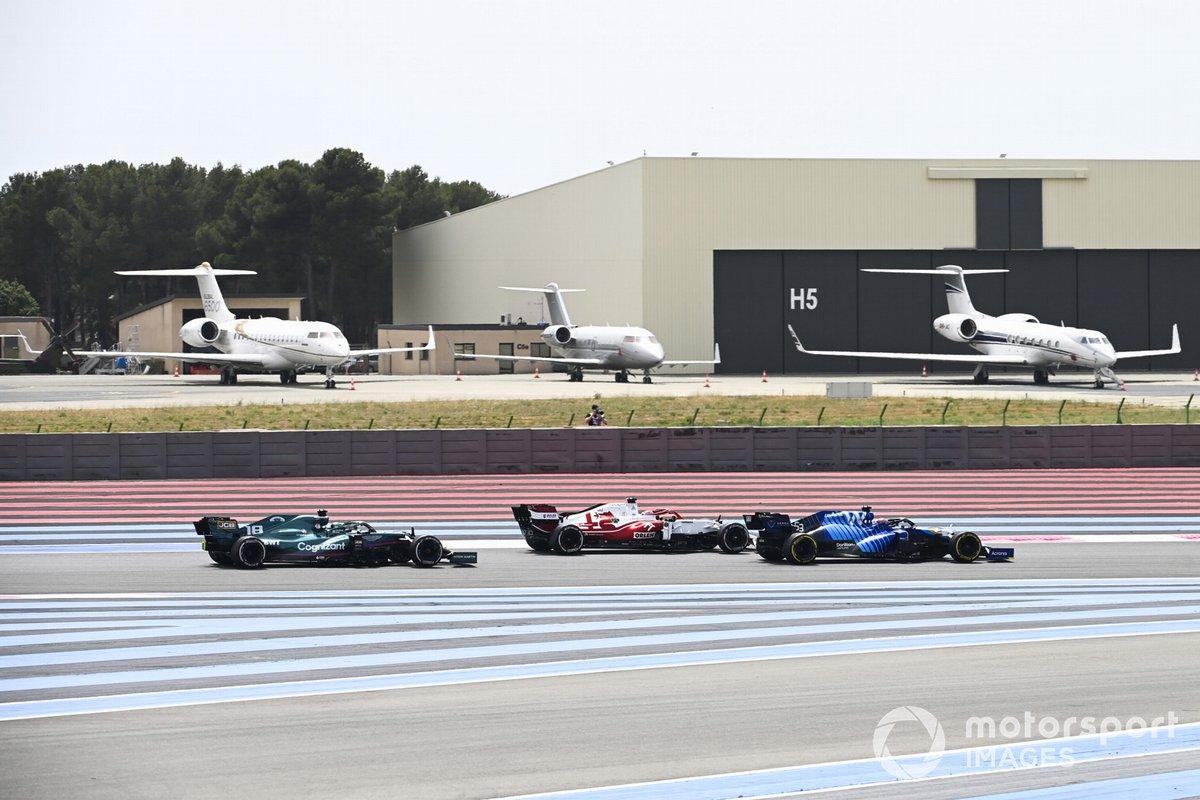 George Russell, Williams FW43B, Kimi Raikkonen, Alfa Romeo Racing C41, and Lance Stroll, Aston Martin AMR21