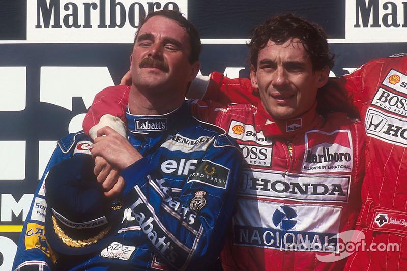 Podium : le second et champion du monde Nigel Mansell, Williams Renault, le vainqueur Ayrton Senna, McLaren Honda