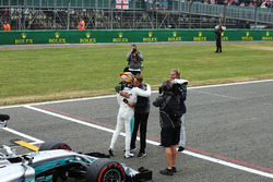 Polesitter Lewis Hamilton, Mercedes AMG F1, is congratulated by Jenson Button