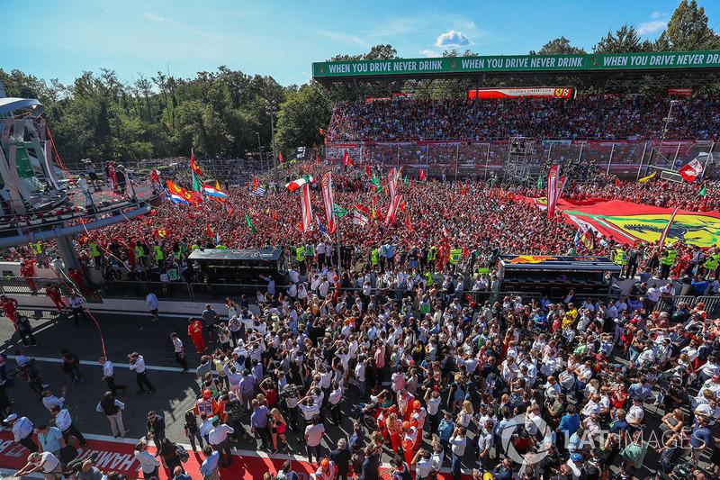 Sebastian Vettel, Ferrari and Lewis Hamilton, Mercedes AMG F1 celebrate on the podium, Ferrari Fans and flags at the podium celebrations