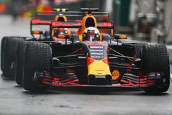 Daniel Ricciardo, Red Bull Racing RB13,. and Max Verstappen, Red Bull Racing RB13, wait in the pit lane