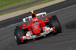 Valentino Rossi, drives the Ferrari F2004, in what was to be a top secret test and he wears one of Michael Schumacher's spare crash helmets