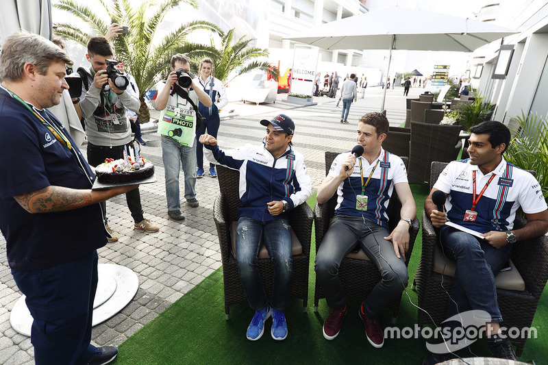 Felipe Massa, Williams, receives a birthday cake, as Paul di Resta and Karun Chandhok look on