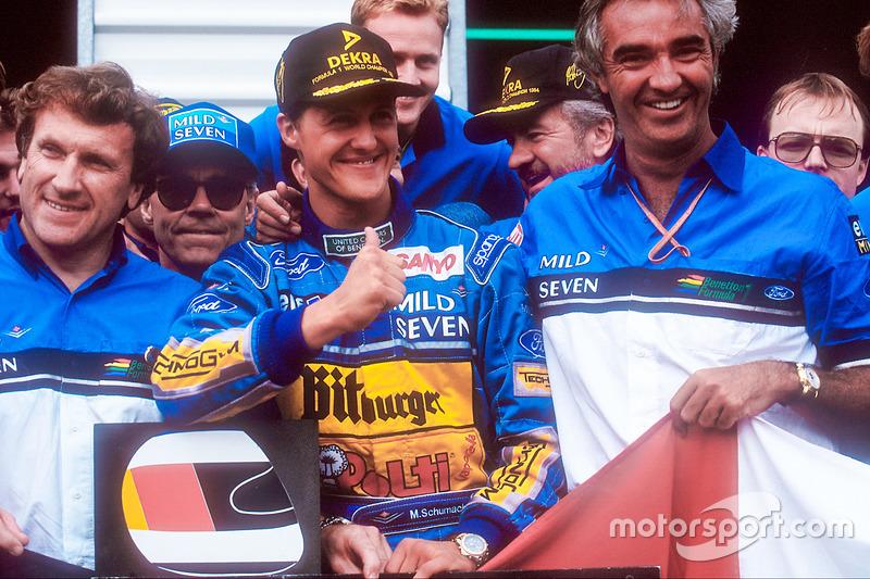 World Champion Michael Schumacher celebrates the Benetton team, Tom Walkinshaw and Flavio Briatore