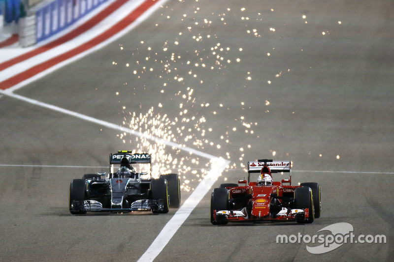 Nico Rosberg, Mercedes F1 W06 Hybrid, sets up a brave overtake down the inside of Sebastian Vettel, Ferrari SF-15T