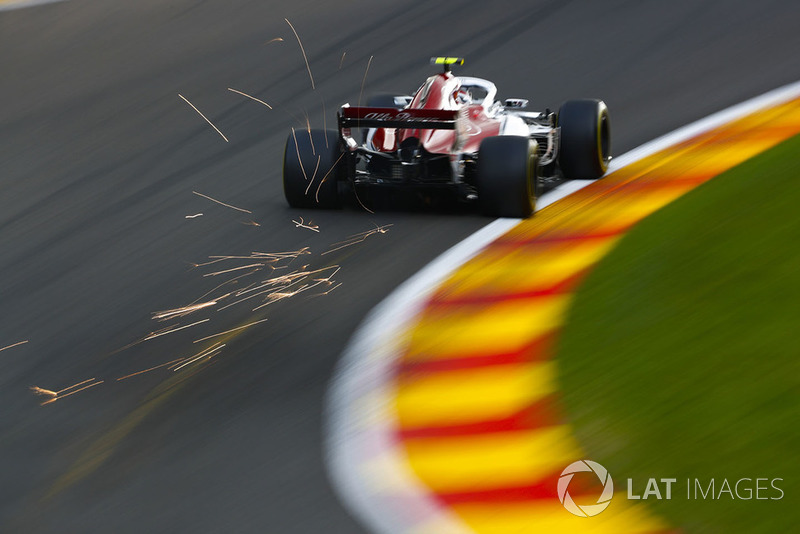 Sparks fly from the rear of Charles Leclerc, Sauber C37