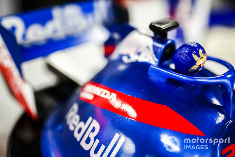 A fan's hat decorated in support of Toro Rosso