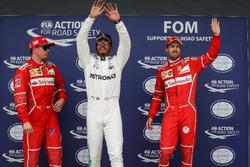 Pole sitter Lewis Hamilton, Mercedes AMG F1, Kimi Raikkonen, Ferrari and Sebastian Vettel, Ferrari celebrate in parc ferme