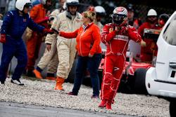 Kimi Raikkonen, Ferrari walks from his Ferrari SF70H after crashing