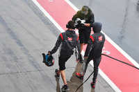 Romain Grosjean, Haas F1 Team walks in after crashing in Q1