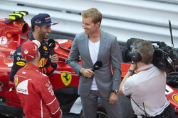 Reigning World Champion interviews Race winner Sebastian Vettel, Ferrari, Daniel Ricciardo, Red Bull Racing, after the podium