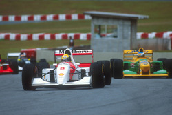 Ayrton Senna, McLaren MP4/8 Ford leads Michael Schumacher, Benetton B192B Ford