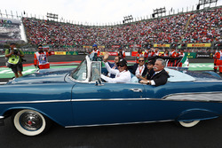 Emerson Fittipaldi drives Chase Carey, Chairman, Formula One, in the drivers parade