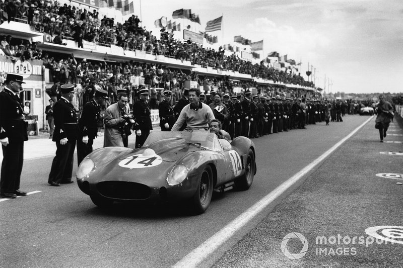 Hill drives co-driver Gendebien to the podium ceremony atop the Ferrari 250TR, following the first of their three Le Mans 24 Hour wins together.
