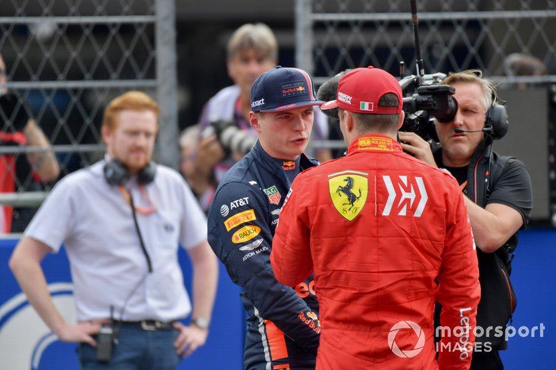 Charles Leclerc, Ferrari, congratulates Max Verstappen, Red Bull Racing, on pole