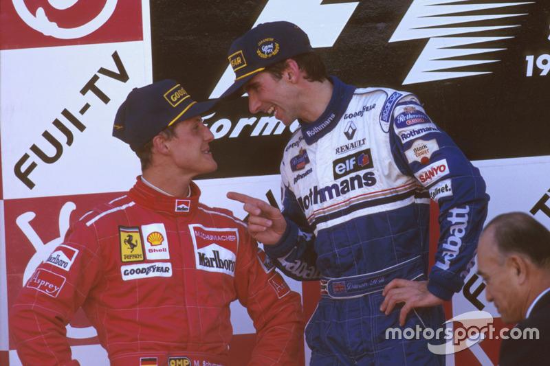 Podium: Race winner Damon Hill, Williams Renault; second place Michael Schumacher, Ferrari