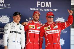 Обладатель поул-позиции Себастьян Феттель, Ferrari, Кими Райкконен, Ferrari, – второе место, Валттери Боттас, Mercedes AMG F1, – третье место