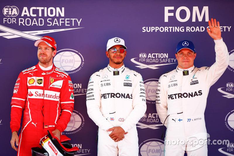 Polesitter Lewis Hamilton, Mercedes AMG F1, second place, Sebastian Vettel, Ferrari, third place Valtteri Bottas, Mercedes AMG F1