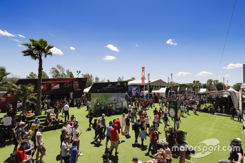 Race goers enjoy the F1 fan village entertainment and activities