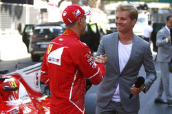 Race winner Sebastian Vettel, Ferrari, is interviewed by reigning World Champion Nico Rosberg