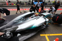 Lewis Hamilton, Mercedes AMG F1 W08, is returned to the garage by his team