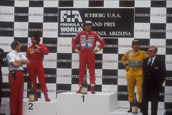 Ayrton Senna, McLaren Honda, 1st position, Alain Prost, Ferrari, 2nd position and Nelson Piquet, Benetton Ford, 3rd position on the podium. McLaren team boss Ron Dennis stands on the left and FIA President Jean-Marie Balestre on the right