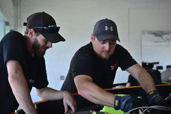 Crews work on the #49 TA2 Dodge Challenger, Ethan Wilson, Stevens Miller Racing