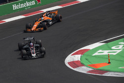 Romain Grosjean, Haas F1 Team VF-17 and Fernando Alonso, McLaren MCL32 battle