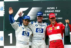Подиум: второе место Хуан-Пабло Монтойя, Williams, победитель гонки Ральф Шумахер, Williams, третье место – Михаэль Шумахер, Ferrari