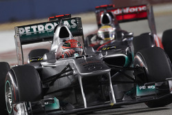 Michael Schumacher, Mercedes MGP W02; Lewis Hamilton, McLaren MP4-26