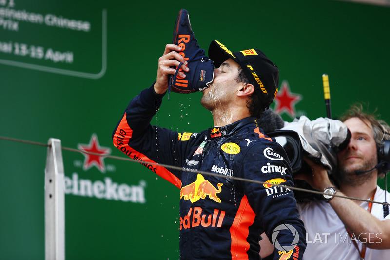 "Race winner Daniel Ricciardo, Red Bull Racing, drinks a champagne ""shoey"" on the podium"
