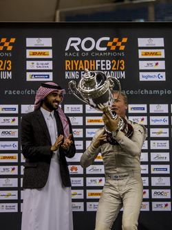 Winner David Coulthard is presented with his trophy