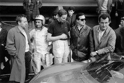 The Ferrari drivers in the pits: John Surtees, Willy Mairesse, Michael Parkes, Lorenzo Bandini and Ludovico Scarfiotti